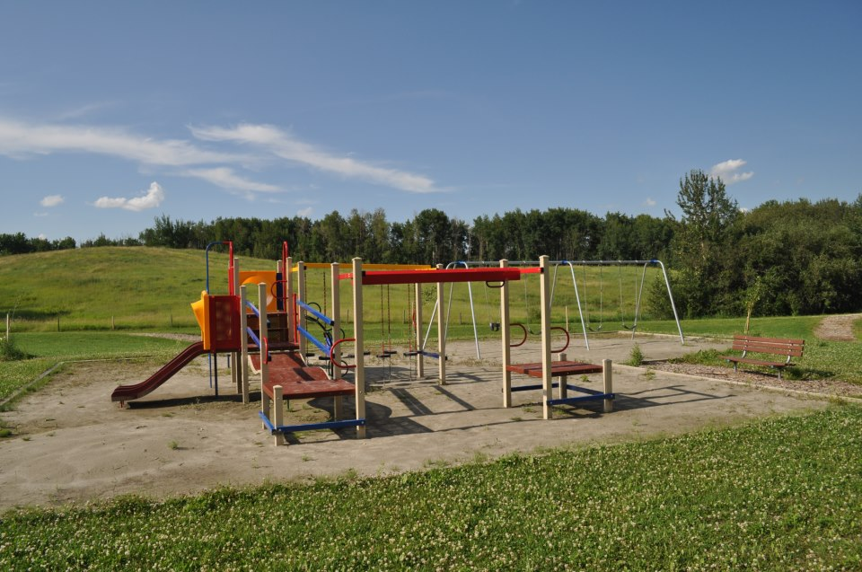 A playground beckons next to the ravine trail